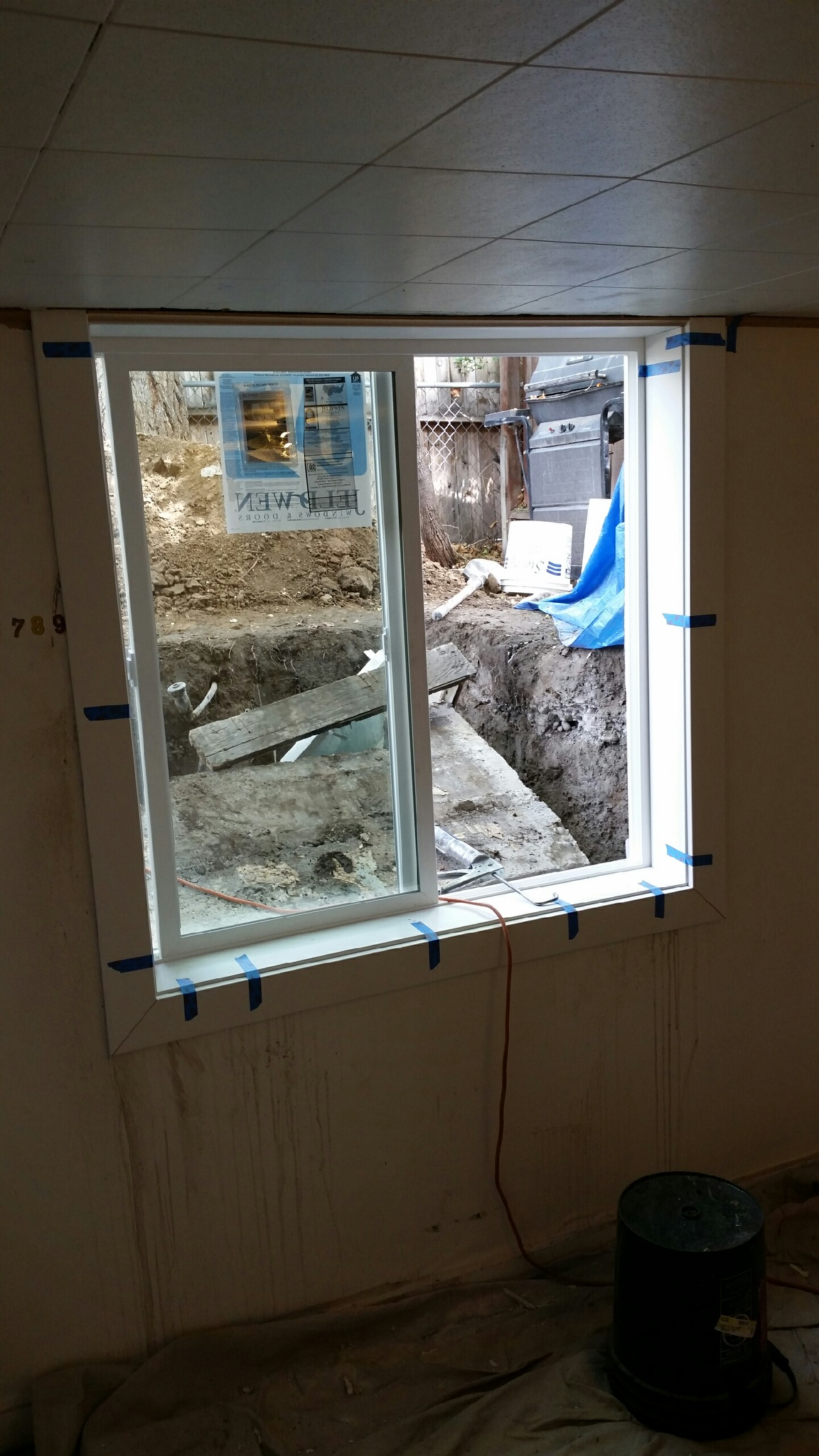 cut a larger window opening installed the new window and well and